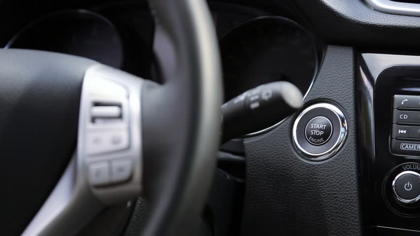 Turn on the car engine with start button | Shutterstock HD Video #12424517