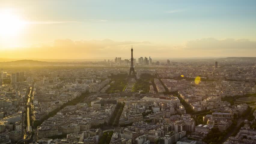 Paris - August 3rd, 2013: Time lapse footage of sunset over Eiffel Tower seen from Tour Montparnasse (Montparnasse 56), Paris, France | Shutterstock HD Video #12433097