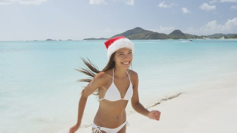 Model In Christmas Vacation.Christmas Beach Girl In Santa Stock Footage Video 100