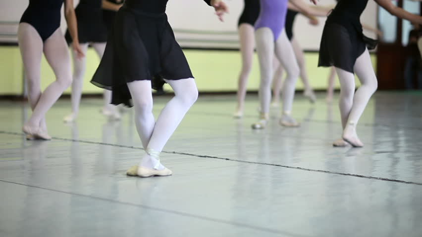 low section view of group of young ballet dancers training at school