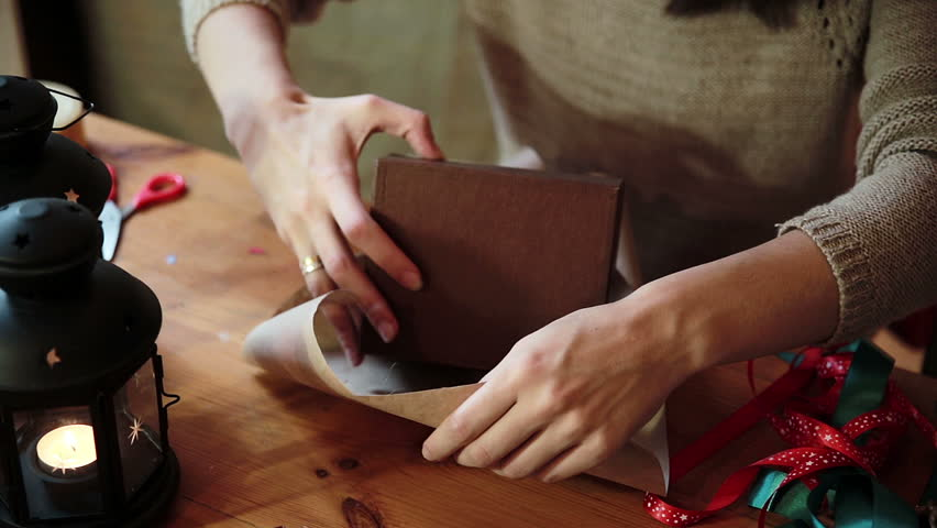 Young Woman Wrapping Christmas Gifts With Brown Paper At Home  #12483065