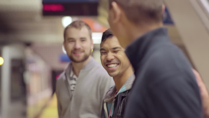 Two Gay Couples Chat While They Wait For Their Subway Train To Pull Up To  Platform