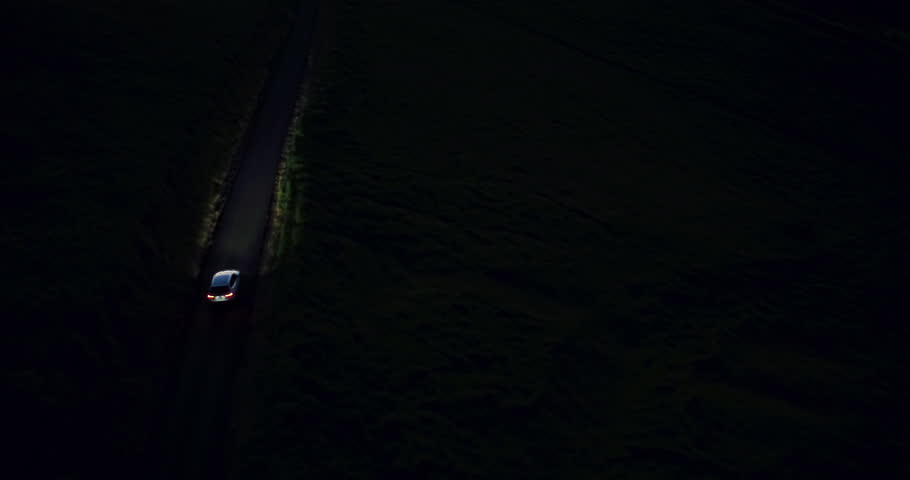 4K Car Driving at Night on Winding Country Road in the Hills. Aerial View. Headlights. | Shutterstock HD Video #12502958