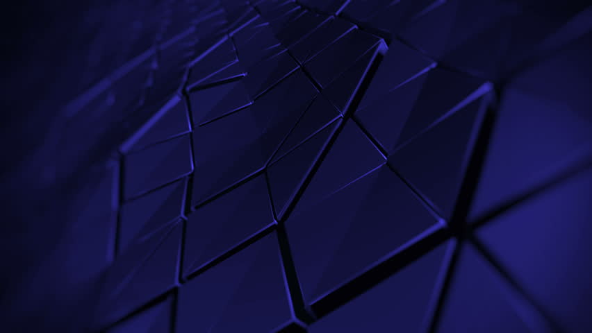 Loopable 3d rendered abstract waved surface made of extruded triangle shapes with shadows and speculars, with depth of field blur