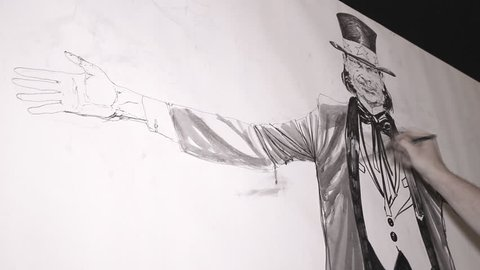 cartoonists draw Uncle Sam ,Drawing comics on panel canvas