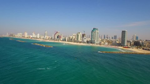 Brilliant aerial views of TEL AVIV skyline and the Mediterranean Sea along the cost of Israel. Filmed using a DJI Inspire drone in 4K.