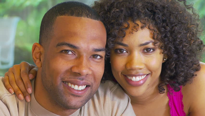 Portrait of African American couple kissing