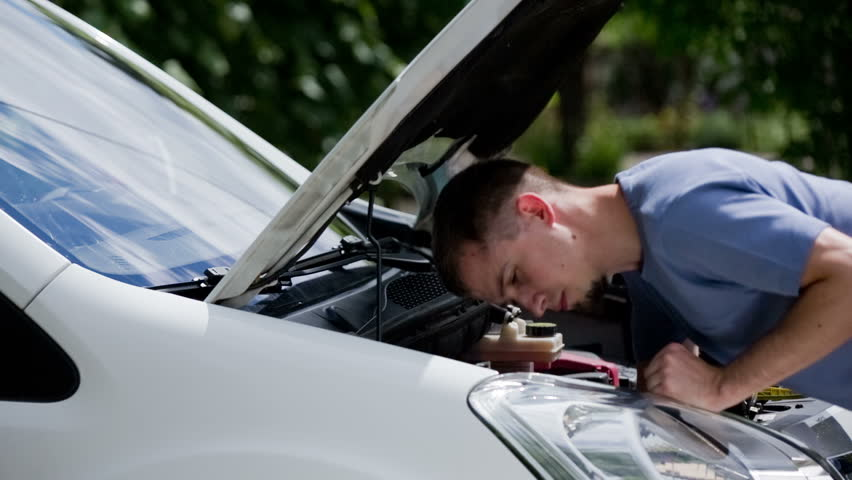 Man Put Head Under Car Stock Footage Video (100% Royalty-free) 12582935 |  Shutterstock