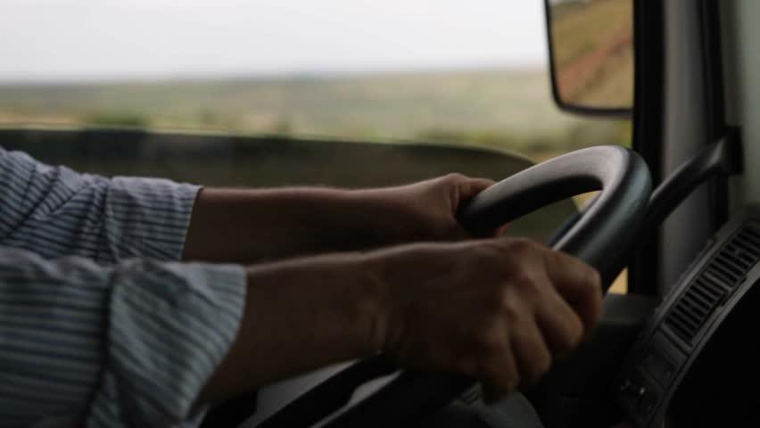 Man's hands driving a truck | Shutterstock HD Video #12583709