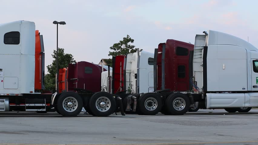 18 Wheeler Transportation in USA: Big Rig (Tractor/Trailer) Cabs Parked at Truck Stop