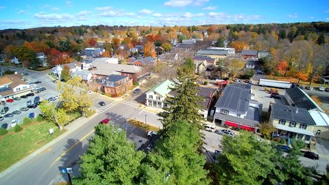 Small town forward 4k aerial, looking at daily life in upstate NY village, Millbrook.in the fall.