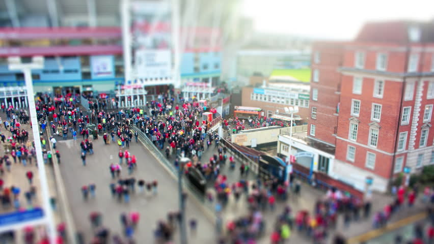 Crowd leaving Stadium. Tilt Shift Timelapse.