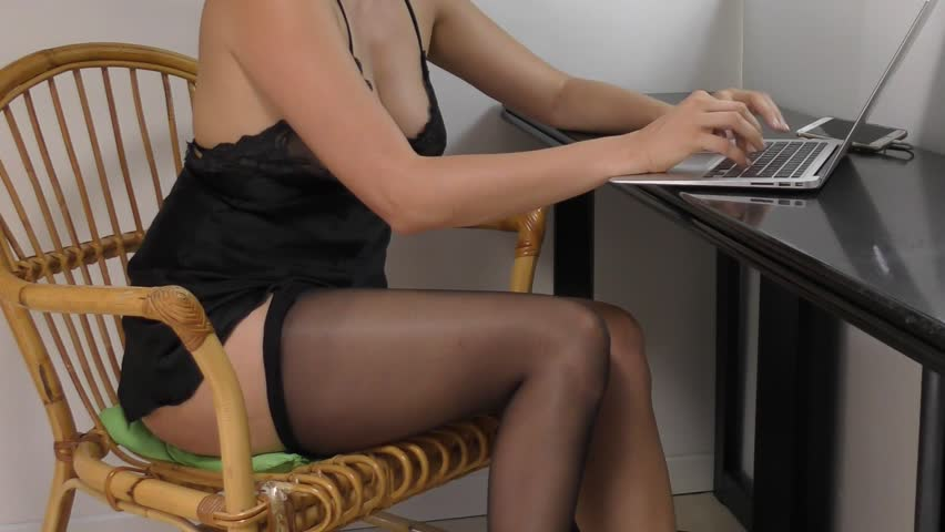 close up sexy girl massaging legs and taking off pantyhose