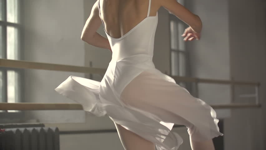 graceful girl practicing ballet in the Studio, slow motion