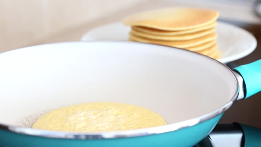 Making home made pancakes on frying pan turning over flapjacks making home made pancakes on frying pan turning over flapjacks hd stock video clip ccuart Image collections