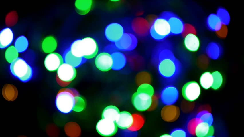 abstract background bokeh lights multicolored red blue green yellow black background blinking garland christmas holiday decoration - Christmas Lights Video