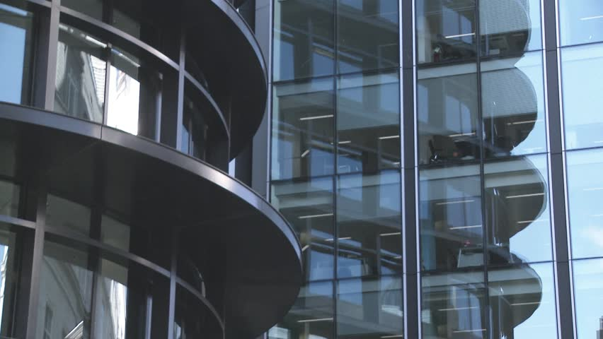 Tilt up Close up of modern office buildings glass fronts