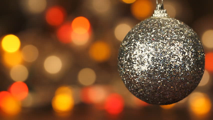 christmas ball on the background of flashing lights blurred bokeh holiday new year decoration christmas lights stock footage video 12727535 - Christmas Sphere Lights