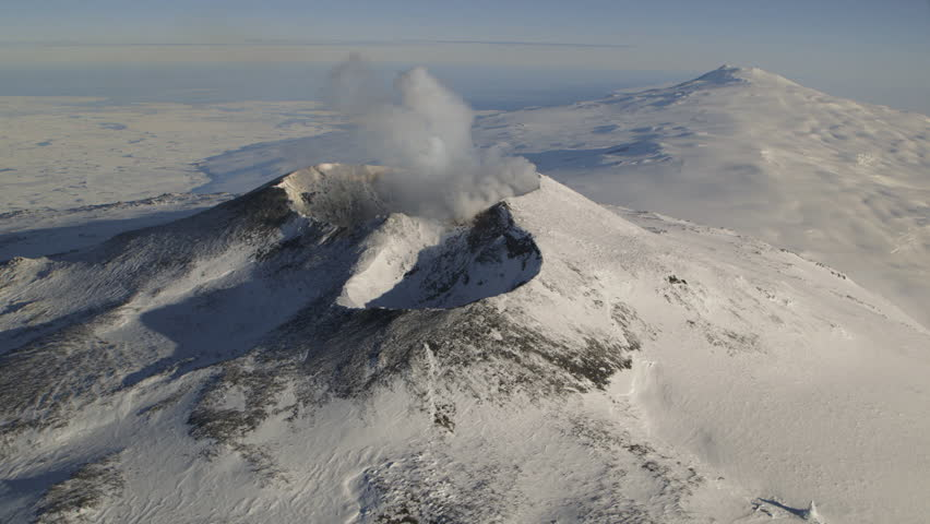 WS AERIAL View of smoke coming out of volcanic crater / Mount Erebus, Antarctica