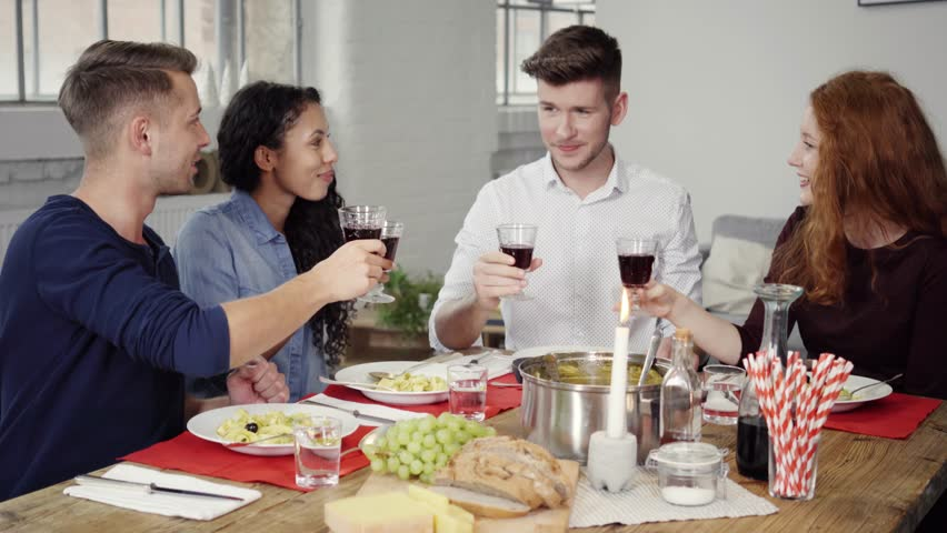Group of Young Successful Friends Tossing Glasses of Wine Together While Having Their Lunch. | Shutterstock HD Video #12832175