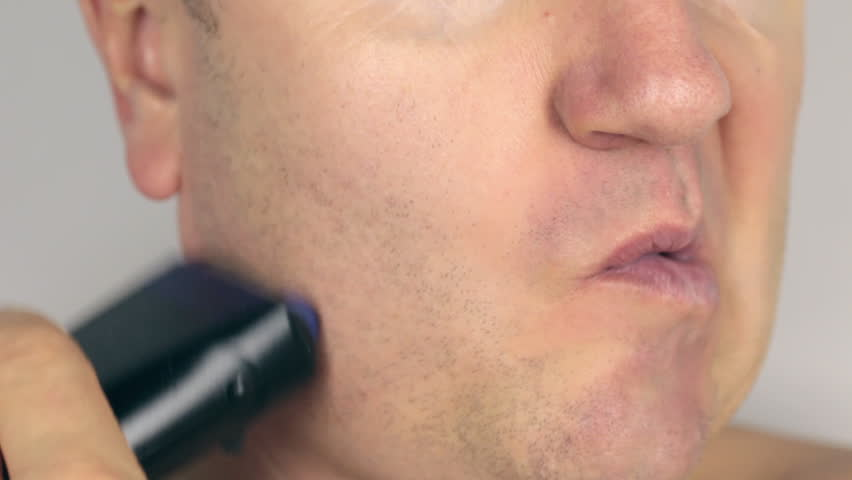 Closeup  shave a man, shave electric razor, the end.  | Shutterstock HD Video #12837083