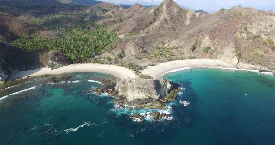 Paga beach aerial - beautifully unique heart shaped beach in Flores, Indonesia | Shutterstock HD Video #12838895