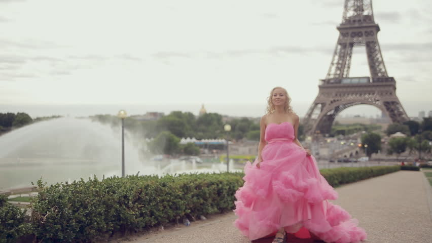Girl in a magnificent long pink dress running from the Eiffel Tower in Paris | Shutterstock HD Video #12859259