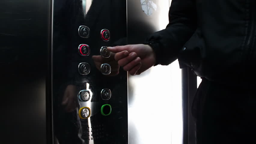 people inside elevator. people inside the elevator, press button with a choice of floor and ride in it. elevator door opens closes. lift modern, clean glossy.