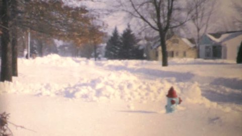 WINNIPEG, MANITOBA, CANADA, JANUARY 1970: A classic Canadiana clip of a winter blizzard hitting hard during the middle of winter of 1970 in Canada.
