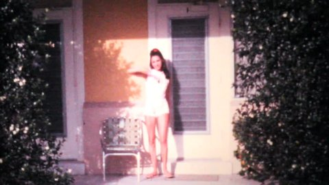 PENSACOLA, FLORIDA, JUNE 1969: An attractive young college aged girl poses in front of her condo while on holidays in the summer of 1969 in Florida.