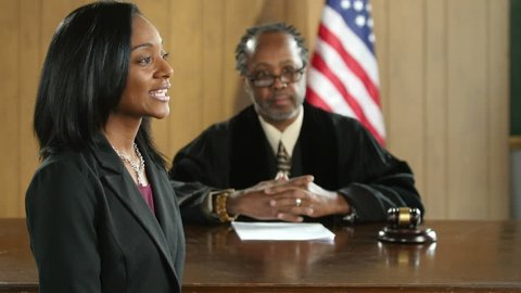 A black female attorney pleading her case before a jury
