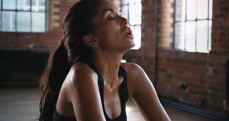 Fitness healthy woman tired after strength training exercise at gym resting slow motion kickboxer series