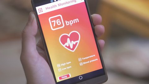 Monitoring the heart pulse with a health application on smartphone.