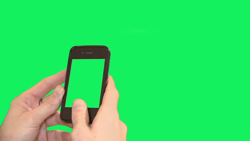 Hands on smart phone over blank green screen - 1080p. Close shot of hands using a smartphone over a green screen background. | Shutterstock HD Video #13001105