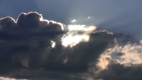 60d3825fc9b Timelapse Of Sun Rays Emerging Though The Dark Storm Clouds In The