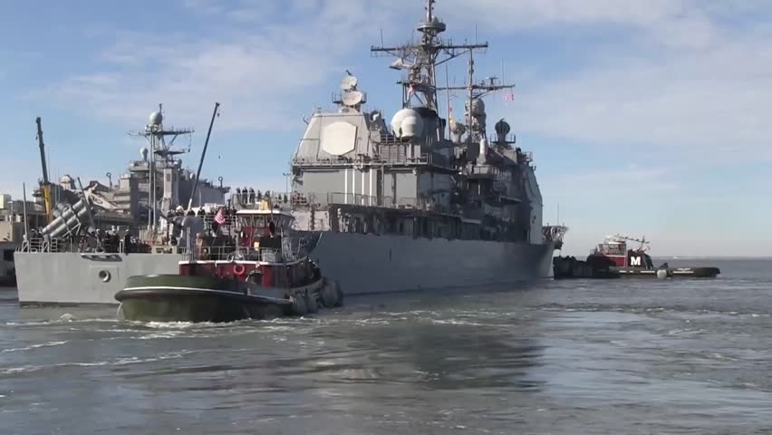 USA Virgina Norfolk, November 2015, medium shot USS Anzio Drive With Two Tugboats Out Harbour