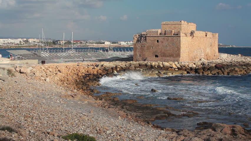 The Pathos Castle on Mediterranean seashore in Cyprus island, waves breaking shore. Pathos city