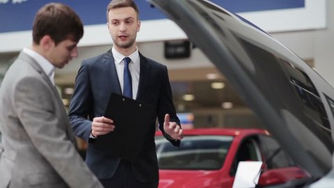 Salesman describes the customer about the quality of the vehicle