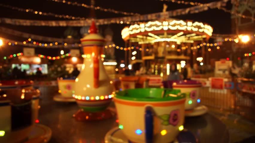 People visit  Christmas Fair in old town at evening. Defocused | Shutterstock HD Video #13094255