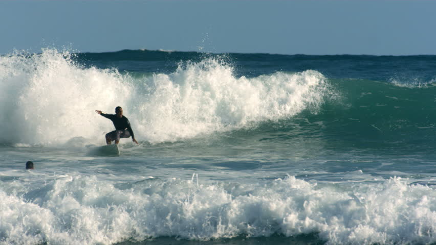 Cinemagraph - Surfer rides wave, Hawaii. Looping Motion Photo.