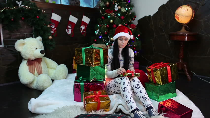 Gifts With Photos On Them Part - 47: Happy And Beautiful Girl Sitting Among Many New Year Presents And Gifts.  Smiling Lady Keeping