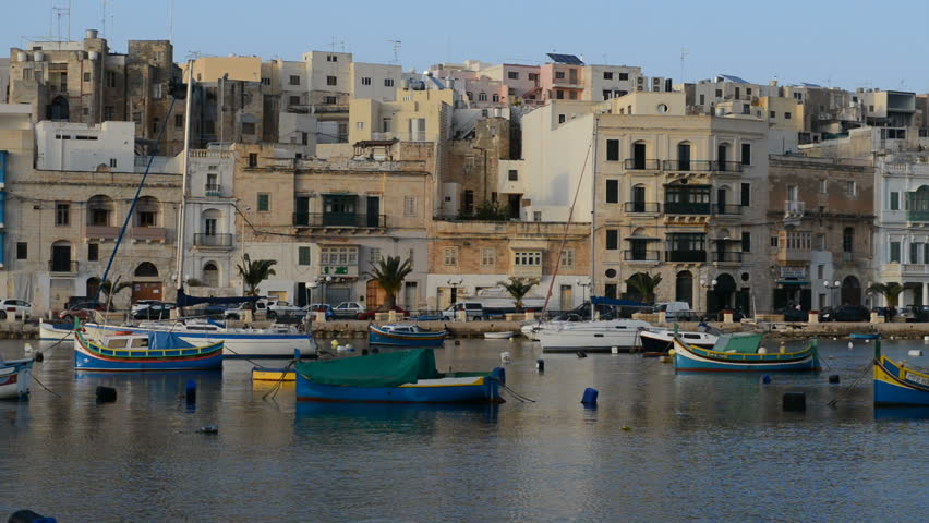 The panning of traditional Maltese boats in sunset, Kalkara, Malta