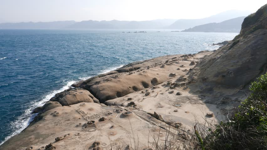 Wonderful odd rock shore, smooth and eroded, panoramic shot at end point of Yehliu Geopark cape, downstairs to East side. Unusual, unreal landscape was created by volcanic formation #13143125