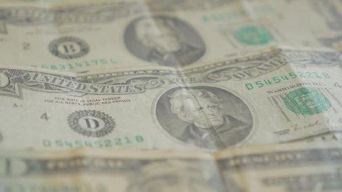 American twenty dolar paper money banknotes in the row slow tilt 4K 2160p 30fps UltraHD footage- Lot of 20 USA dollar banknotes close-up 4K 3840X2160 UHD video