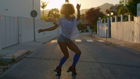 Sexy Roller Skate Girl Dancing on the Street at Sunset Rays on Slow Motion Video