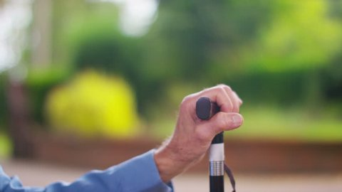 4K Caring young home support worker holding the hand of elderly gentleman with a walking stick. Shot on RED Epic