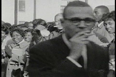 CIRCA 1960s - Sympathetic white college students rally around Jim Farmer and Jackie Robinson about Civil Rights in the 1960s.