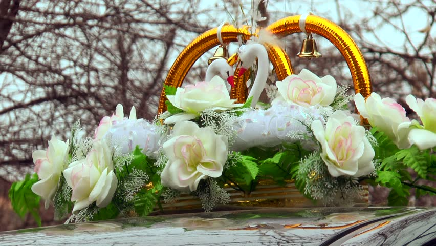 Wedding decoration ring on top of the car stock footage video decoration on wedding car flowers ring bells swans hd stock video clip junglespirit Image collections