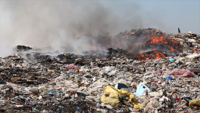 hazards of burning waste pollution and Burning waste materials in dioxin as a 200 ton/day municipal incinerator operating with air pollution health hazards - trash and wood burning.