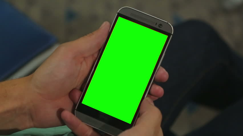 Closeup of male hands holding smart phone with green screen prekeyed for effects. Useful mobile application booking, ordering services, shopping online. Modern communication technology, gadget games  #13262075